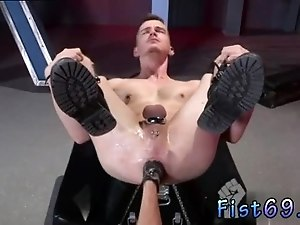Handsome male gay porn stars nude Axel Abysse crouches on a fisting bench